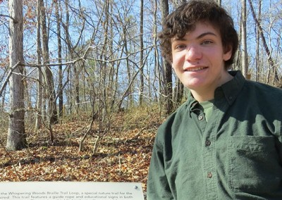 Evan at the Whispering Woods Braille Trail.