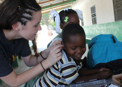 Grace in Haiti, creating molds for Mackenlay's hearing aid.