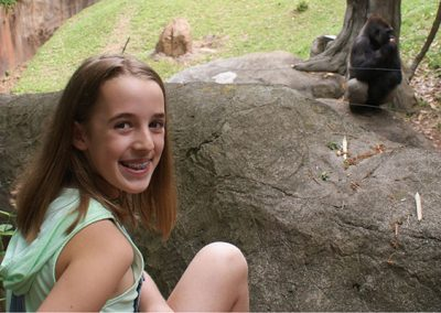 Addison, founder of Gorilla Heroes, viewing gorillas at Zoo Atlanta