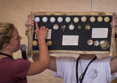 Alex presenting a display board (showing how golf balls deteriorate from forces in the ocean) at the Algalita Plastic Ocean Pollution youth summit last February.