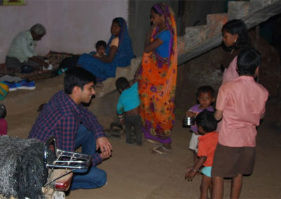 Aryaman speaking with children who, due to the MAHAN Trust's efforts, have been able to progress out of malnutrition to a healthy style of living.