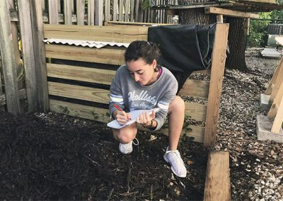 Emma recording numbers as she conducts composting research