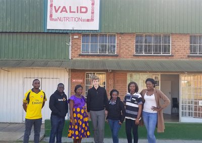 Garyk with the team at Valid Nutrition's therapeutic food factory in Lilongwe, Malawi