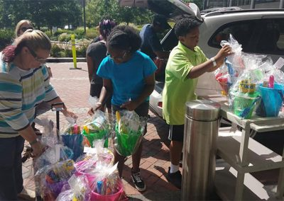 Grace and friends loading up Easter baskets to deliver to children at Johns Hopkins University hospital