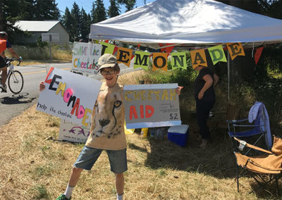 Joris selling lemonade to raise money to help cheetahs.