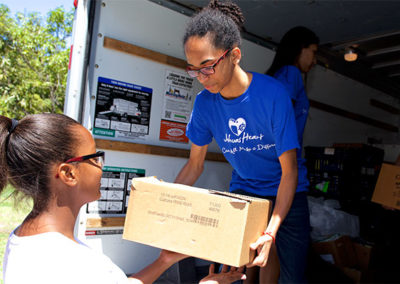 Joshua and other volunteers unload food to be distributed at an event in Florida.