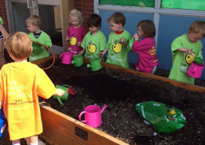 Young participants in a North County Preschool gardening workshop, led by Sophie.