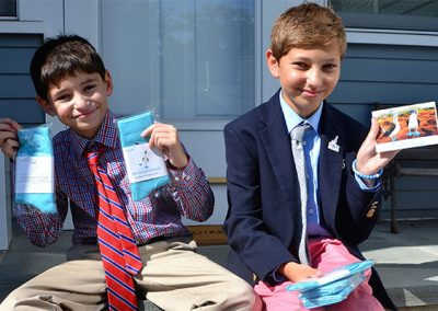 Will and Matthew with their blue socks to benefit the Galapagos' endangered Blue-Footed Booby